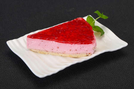 Soft Raspberry cheesecake served mint in the plate