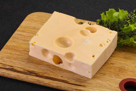 Maasdam cheese brick with thyme branch Archivio Fotografico