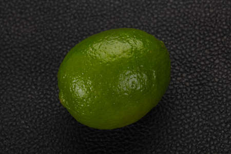 Ripe green lime over the wooden background Archivio Fotografico
