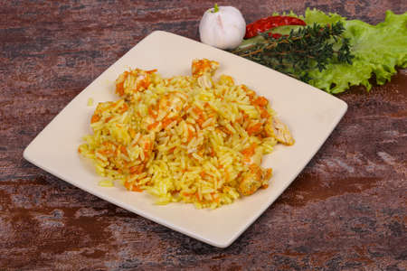 Traditional Pilaf with chicken and carrot served garlic and thyme Reklamní fotografie