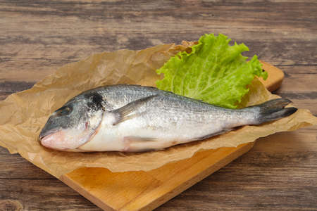 Raw Dorada fish ready for cooking