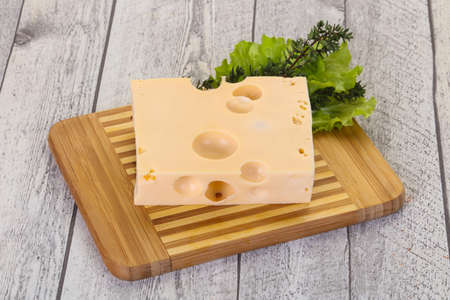 Maasdam cheese brick with thyme branch 스톡 콘텐츠