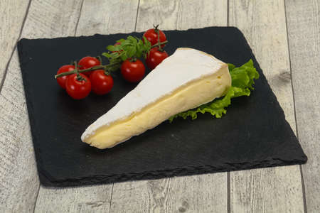 Brie cheese triangle served salad leaves 스톡 콘텐츠