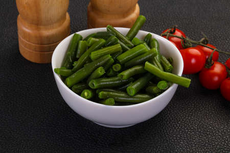 Green beans in the bowl ready for cooking 版權商用圖片