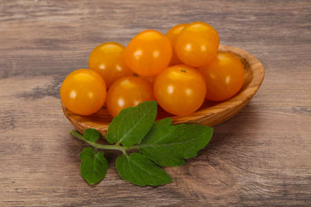 Ripe tasty yellow cherry tomato in the bowl