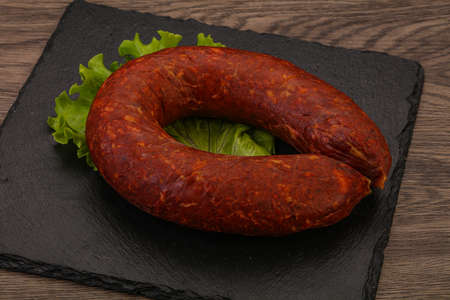 Krakowska sausage over the board with herbs and spices Reklamní fotografie