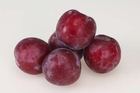 Sweet ripe plum isolated on white background