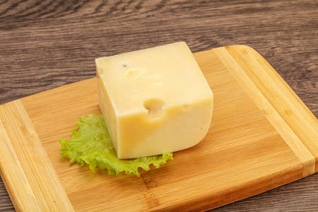 Emmental cheese over wooden board served salad  스톡 콘텐츠