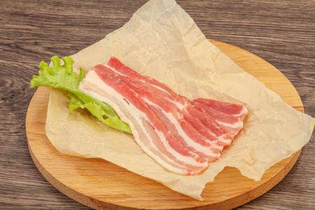 Raw sliced pork bacon for roast