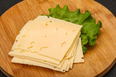 Sliced yellow cheese over salad leaves 스톡 콘텐츠