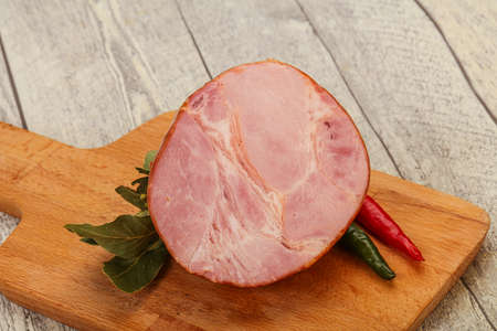 Ham cut in the board served laurel leaves