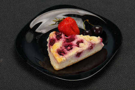 Cheesecake with cherry served strawberry and mint