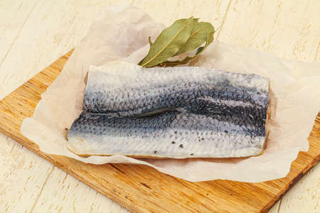 Herring fillet with skin and spices over board Stockfoto