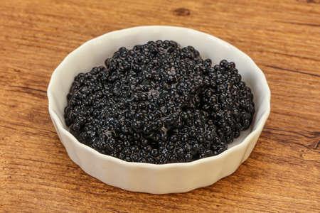 Luxury strugeon fish black caviar in the bowl