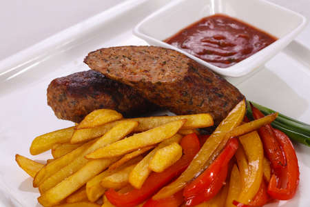 Roasted sausage with fried potato and vegetables