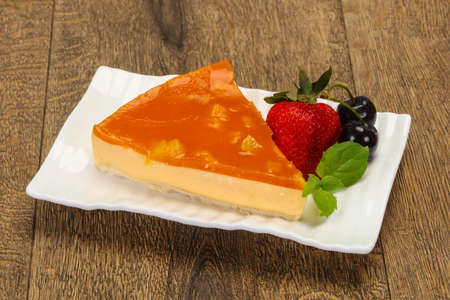 Cheesecake with apricot served strawberry and mint Reklamní fotografie