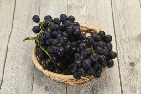 Fresh ripe sweet red grape on the branch