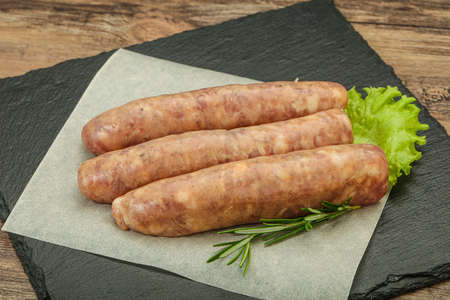 Raw pork meat sausages for grill served rosemary Stock fotó