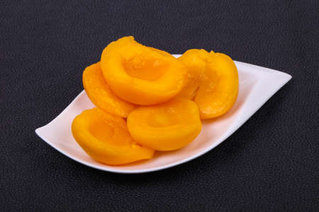 Sweet marinated peach slices in the bowl