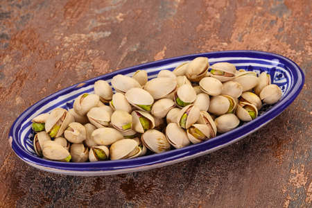 Pistachio nuts heap in the bowl 스톡 콘텐츠