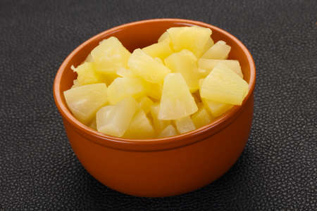 Marinated pineapple pieces in the bowl 스톡 콘텐츠