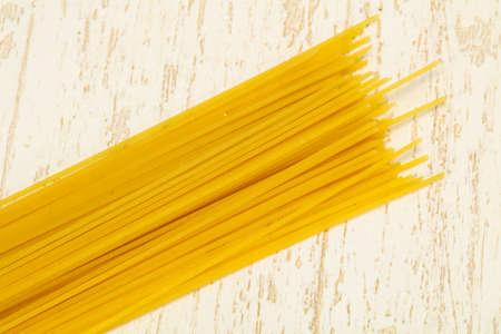 Dry raw spaghetti ready for bowling Stockfoto