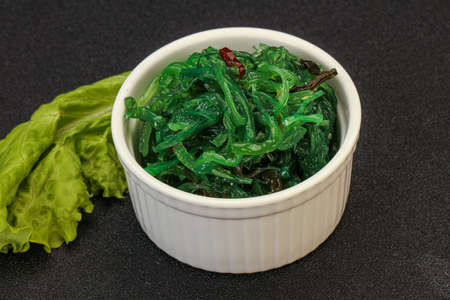 Green Chuka Seaweed Salad Isolated on White Background Top View. Wakame Sea Kelp Salat, Chukka Sea Weed, Healthy Algae Food