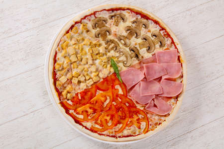 Pizza assortment mix with ham and mushrooms