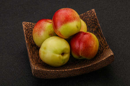 Sweet small green nectarines in the basket