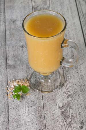 Dietary vegetarian oats milk over wooden background