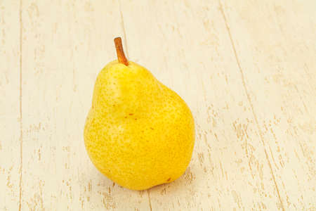 Fresh sweet yellow pear over background 写真素材