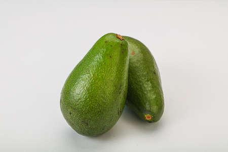 Two ripe exotic green avocado vegetable