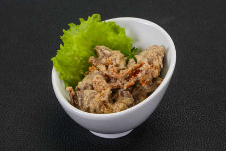 Chicken liver with cream and dry tomatoes served thyme 写真素材