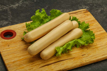 Chicken white sausage with salad leaves 版權商用圖片