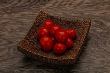 Pickled red cherry tomatoes in the bowl