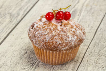 Sweet tasty muffin with red currants berries