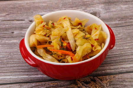 Spicy pickled cabbage with carrot and chili pepper Reklamní fotografie