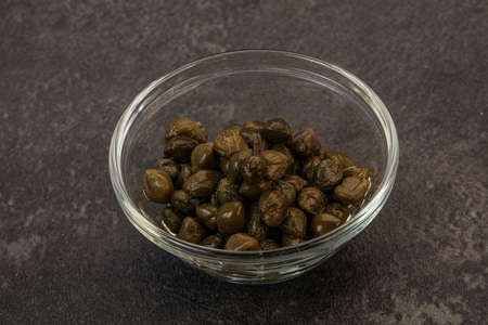 Tasty marinated capers in the bowl
