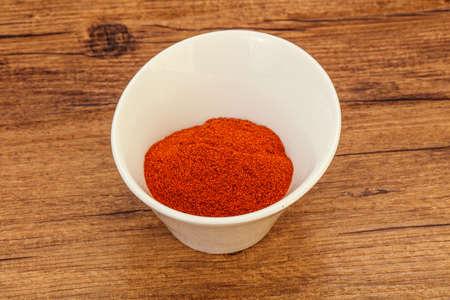 Dry paprika powder in the bowl for cooking Reklamní fotografie