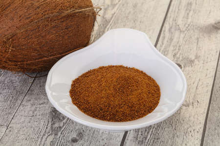 Coconut brown sugar in the bowl over wooden background Banco de Imagens