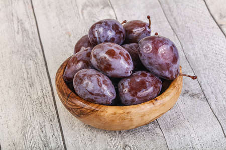 Sweet and rasty ripe plum in the bowl