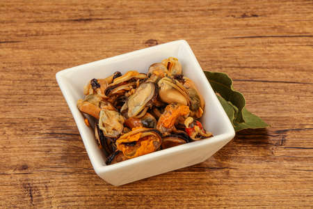 Pickled mussels with spices in the bowl