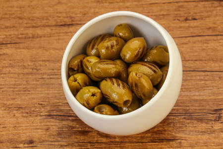 Tasty Green grilled olives in the bowl