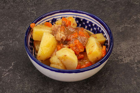Roasted potato and beef with sauce and vegetables