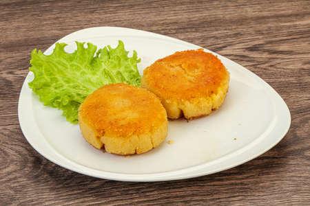 Vegan cuisine - Roasted Potato cutlet in the plate