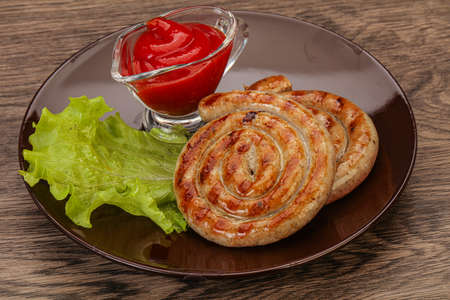 Grilled round pork tasty sausages with sauce