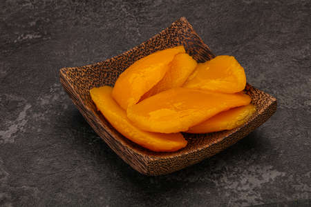 Sweet delicous mango slices in syrop