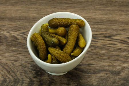 Pickled young gherkin in the bowl Banco de Imagens