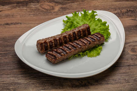 Two Grilled kebeb beef sausages with spices 免版税图像