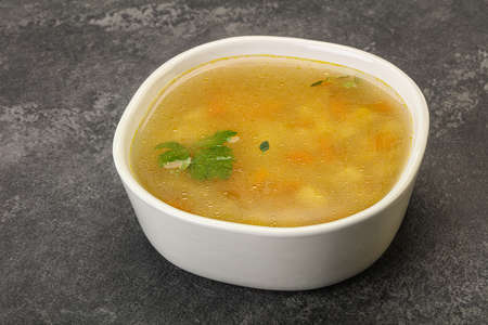 Tasty chicken soup with carrot and potato